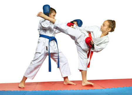 overlays: With overlays on the hands two athletes are training kick leg and protection Stock Photo