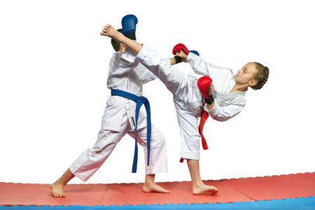 overlays: Two athletes with overlays on the hands are training paired exercises of karate Stock Photo