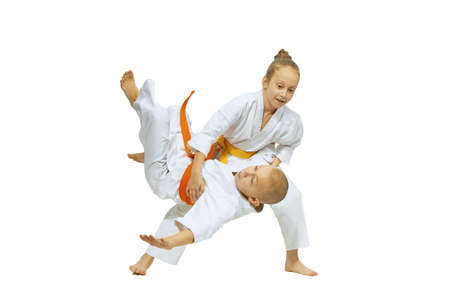 The girl is throwing the boy throw judo