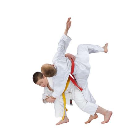 jiu jitsu: High throw in perfoming athlete with a yellow belt