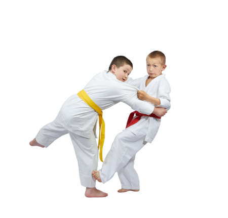 sweeps: Children athletes are training slicing down under leg