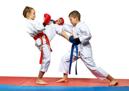 girl kick: Girl beats boy mae geri kick in the stomach Stock Photo