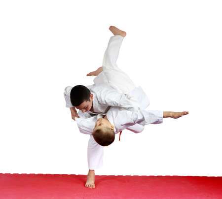 throws: Judo throws in performing athletes in judogi Stock Photo