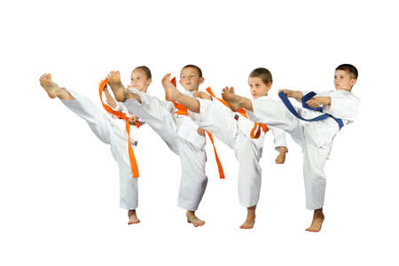 The four athlete are beating kicking on a white background isolated
