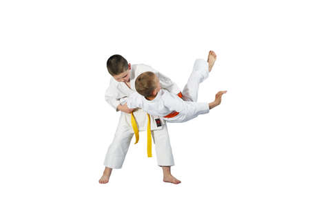 throws: Children are doing high throws judo in judogi