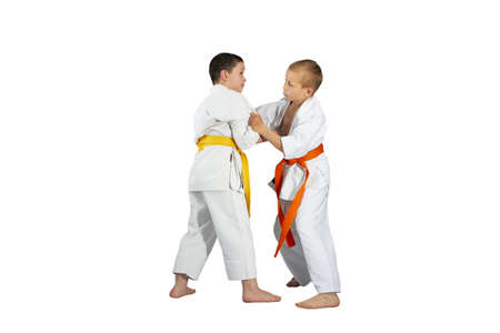 throws: Boys are training Judo techniques against a white background Stock Photo