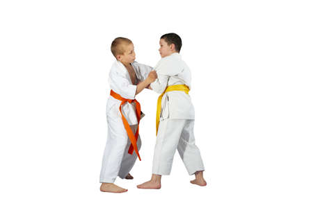 throws: Techniques Judo in performing athletes in judogi Stock Photo