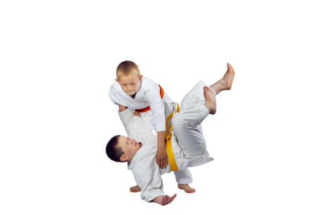 throws: Active athletes in judogi are doing throws judo Stock Photo