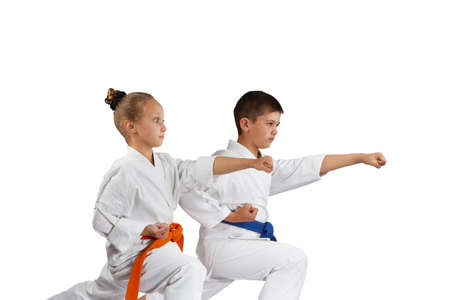 karate boy: Children are beating punch hand in rack of karate Stock Photo