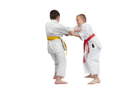 capturing: Boys in karategi are training for capturing karategi