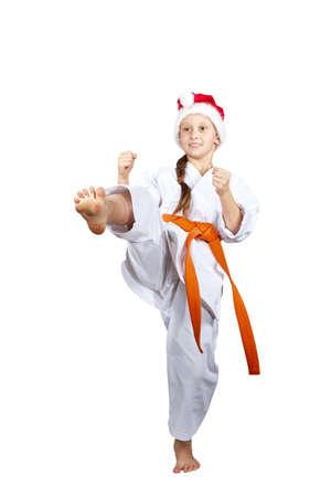 arts: The cheerful girl in a Santa Claus cap beats kicking
