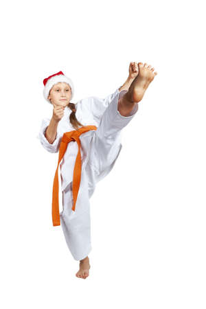 girl kick: In cap Santa Claus girl beats a kick leg