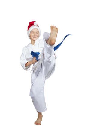 thai arts: Cheerful sportsman in cap  Santa Claus hits a kick Stock Photo