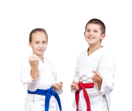 arts: With red and blue belt the children stand in rack of karate
