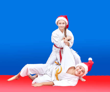 arts: Children in cap of Santa Claus are training throws Stock Photo