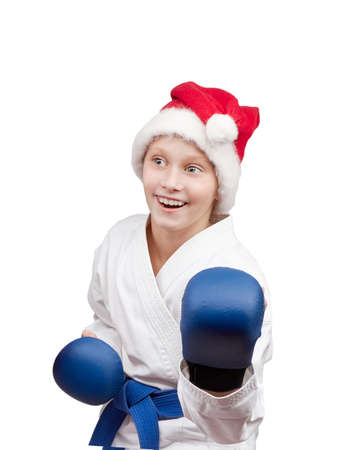 thai arts: Girl in hat of Santa Claus standing in rack of karate