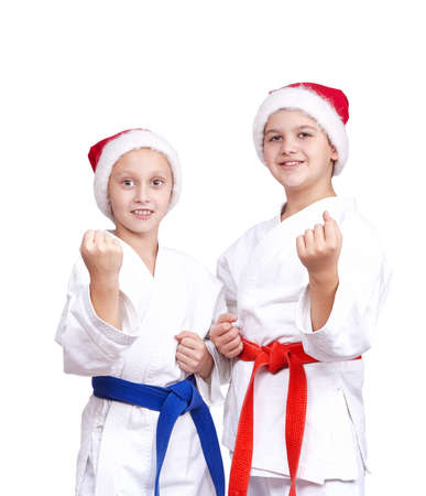 arts: Two athletes in caps of Santa Claus are standing in rack