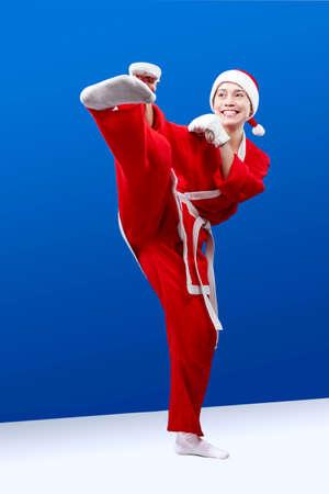 jiu jitsu: A girl dressed as Santa Claus doing karate kick