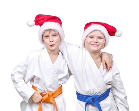 wearing santa hat: Cheerful friends hugging in a kimono and wearing Santa hat