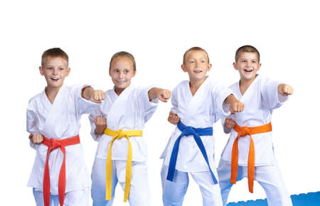 karate: cheerful athletes are hitting punch hand