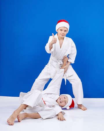throws: Two athletes trains judo throws