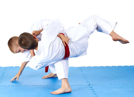 jiu jitsu: Two sportsmens are training judo throws