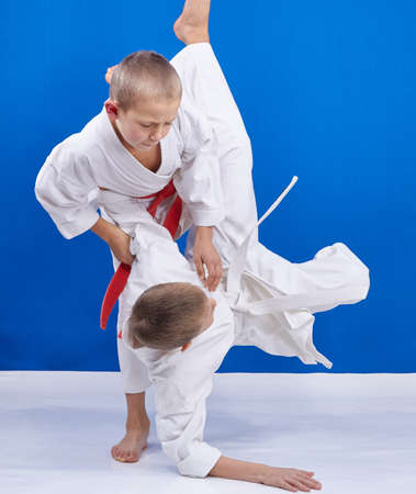 martial art: Boys are doing throws in judogi