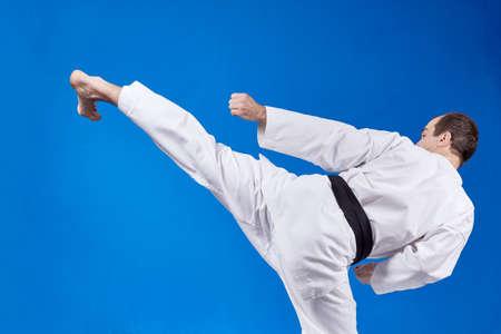 jiu jitsu: On a light background athlete beats kicking