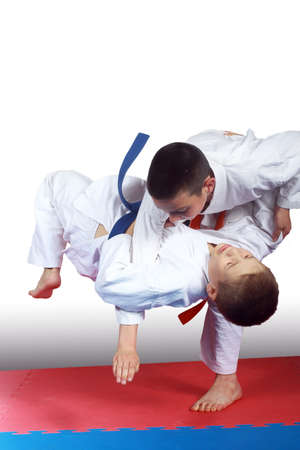 throws: Two athletes in judogi are doing throws