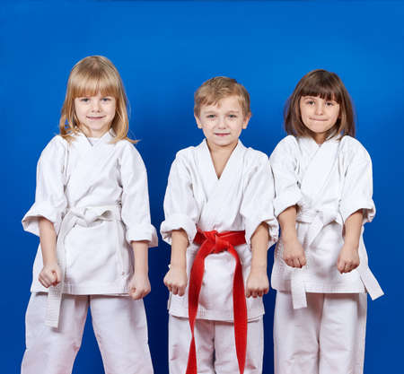 thai girl: Boy and two girls are standing in the rack karate