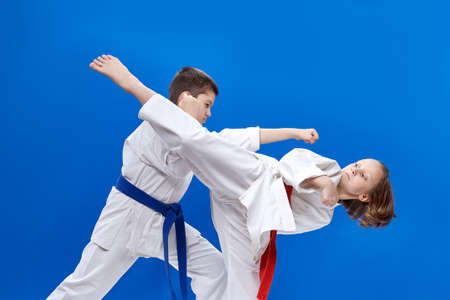 beating: Children are beating karate blows