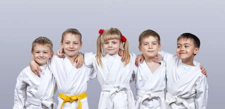 On a gray background little athletes in karategi Banco de Imagens
