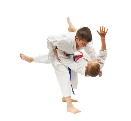 Children on a white background are doing throws Stock Photo