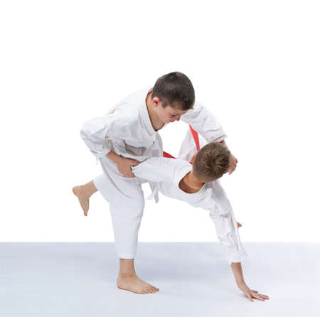 Judo throws in perfoming boys in judogi Stock Photo