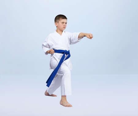Karate kick athlete is beating in karategi