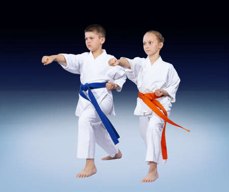 beating: Karate kids are beating punch arm Stock Photo