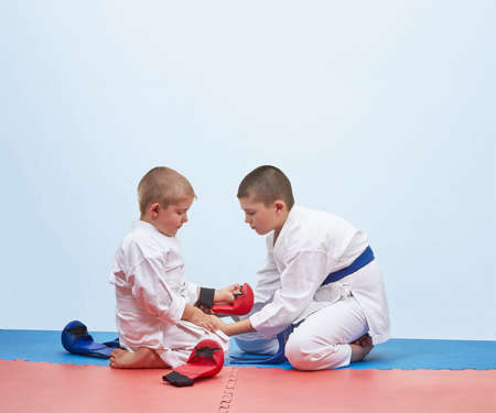 Two karate athlete to dress overlays on hands Stock Photo