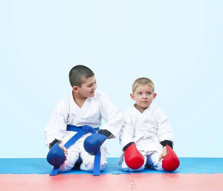 In karategi athletes sit in a karate pose Stock Photo