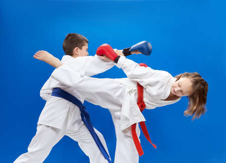 overlays: With red and blue overlays on his hands athletes train blocks and bumps