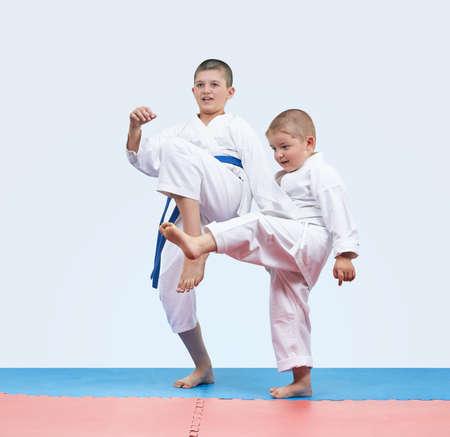 Boys athletes beat kick leg forward Stock Photo