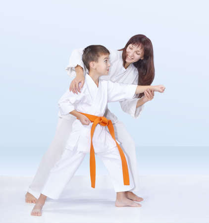 Mother and son are training karate kick Stock Photo
