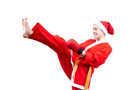 jiu jitsu: On a white background athlete beats a kick in the suit of Santa Claus