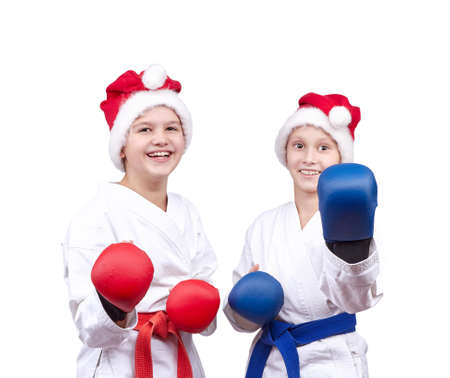 overlays: With red and blue overlays on the hands children stand in the rack karate