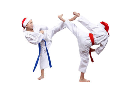 Boys are beating roundhouse kick to meet each other