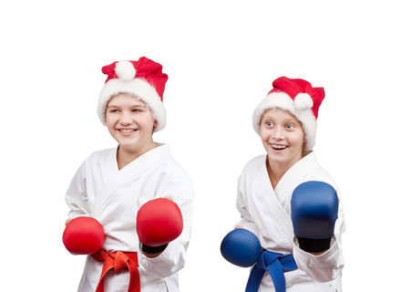 overlays: Children sportsmen are in the rack karate with the overlays on the hands