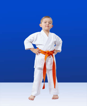 Boy in karategi on a blue background Stock Photo