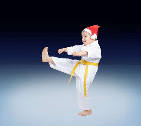 Boy beats a kick leg on a gradient background