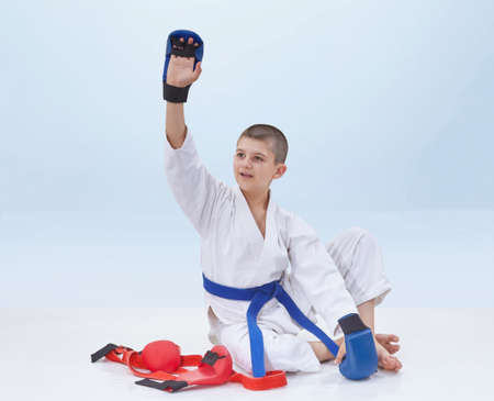 On a light background karate athlete raised his hand in greeting on a light background karate athlete raised his hand in greeting stock photo 74822653 m4hsunfo