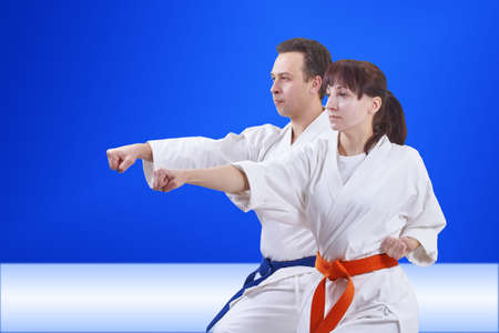 In karategi couple are training punch arm