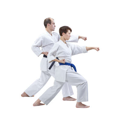 Brother and sister hit a punch on a white background isolated